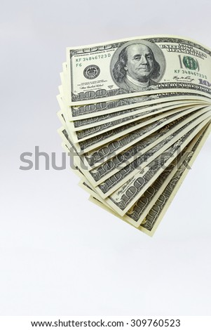 A stack of hundred-dollar bills on a white background