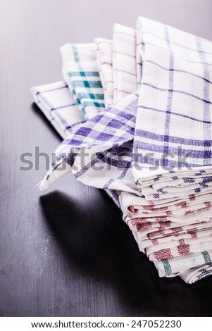 a stack of kitchen dish cloth or canvas in various colors - stock photo