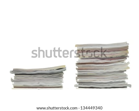 A stack of magazines isolated against a white background