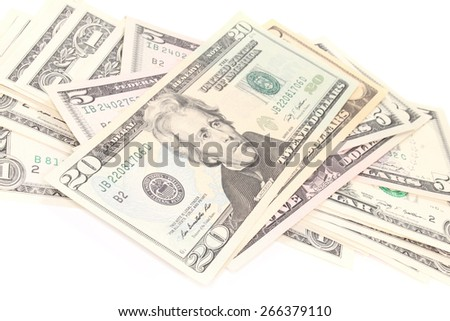 a stack of many colorful dollar bills on white background - stock photo