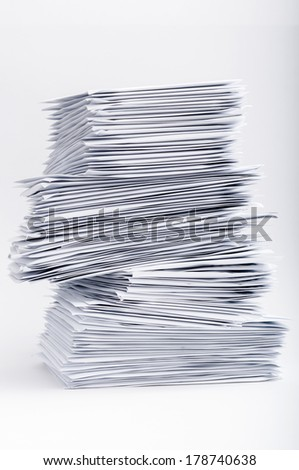 A stack of many letters. Not all of them are laying smoothly. Some are twisted along edges.  - stock photo