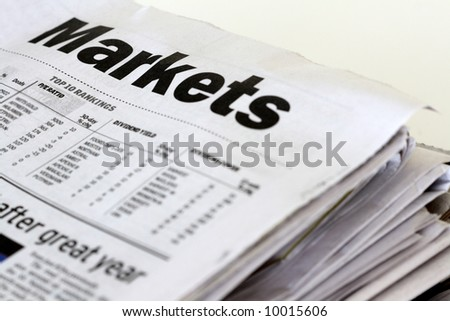 A stack of marketing newspapers on a white background