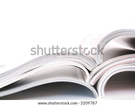 a stack of megazines on white background