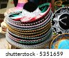 A stack of mexican hats for sale at Chichen Itza. They are very colorful and well crafted - stock photo