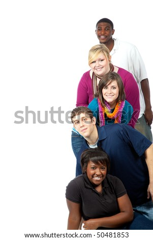 A stack of multi-racial college student/friends on a white background with copy space - stock photo
