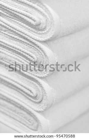 A stack of new white towels close-up - the background - stock photo