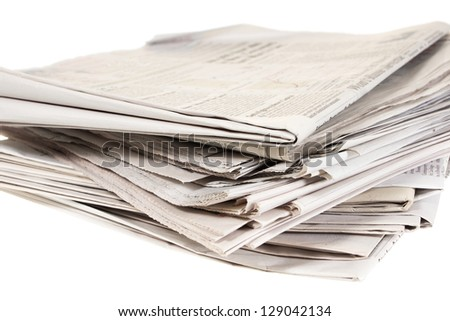A stack of newspapers isolated on white background - stock photo