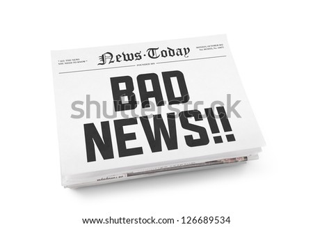 "A stack of newspapers with headline ""Bad news"" on a front page. Isolated on white. - stock photo"