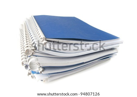 A stack of notebooks. Isolated on a white background. . Clipping path. - stock photo