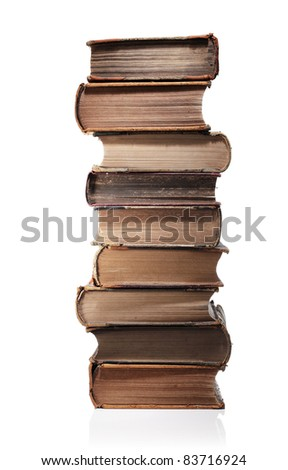 A Stack of old books isolated on white with natural reflection.