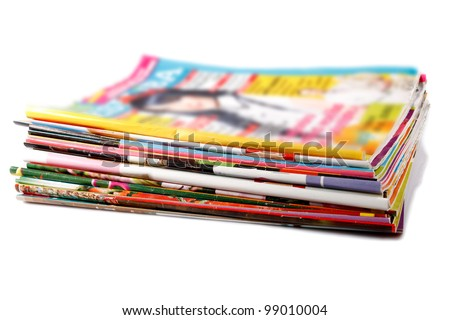 a stack of old colored magazines on white - stock photo