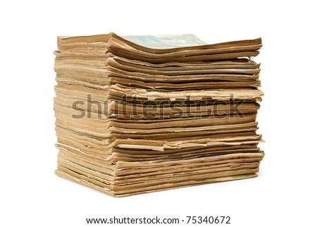 a stack of old magazines on white background - stock photo