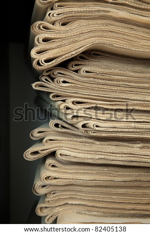 A stack of old newspapers, old, fat yellow. - stock photo