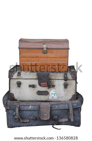 A stack of old suitcases trunks and cases isolated with clipping path on pure white