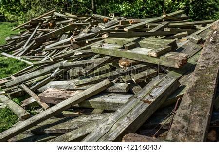 A stack of old timber piled up.