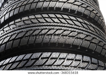 a stack of old tires - stock photo