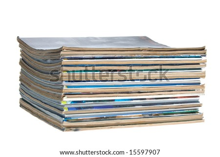 A stack of old worn magazines isolated against a white background.