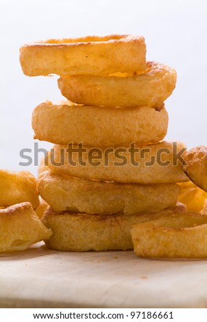 A stack of onion rings - stock photo