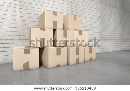 A stack of regular brown cardboard boxes taped shut on an an an empty industrial warehouse background - stock photo