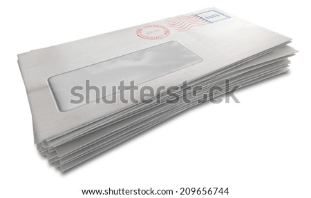 A stack of regular white envelopes with delivery stamps and a clear window on an isolated white background - stock photo