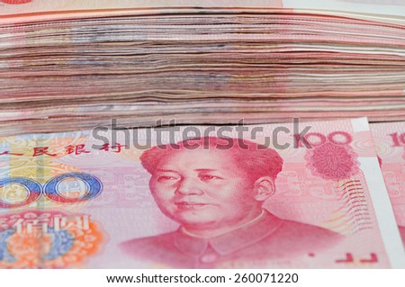 A stack of 100 renminbi or yuan Chinese money.