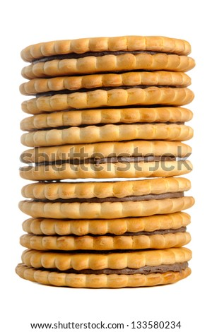 A stack of sandwich cookies with chocolate cream isolated on a white background