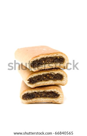 a stack of three fig newton cookies