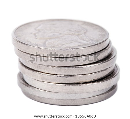 A stack of 5 US cents (Nickel) coins isolated on white background. The obverse side of the coin is seen here, depicting Thomas Jefferson's profile portrait. - stock photo