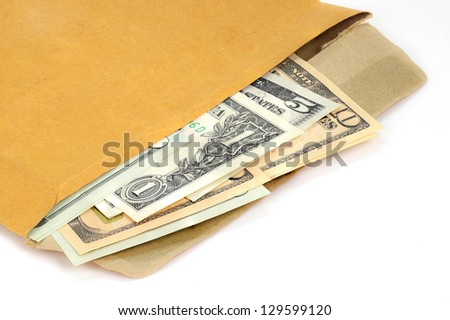 A stack of US dollar currency bills in an open brown paper envelope - stock photo