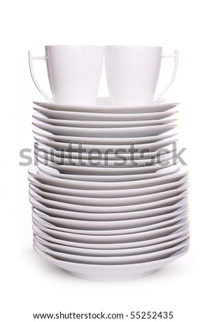 a stack of white dishes and cups isolated on white - stock photo