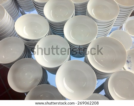 a stack of white dishes en soup bowls - stock photo