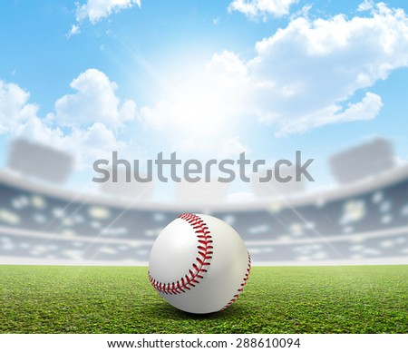 A stadium with an unmarked green grass pitch and a white baseball ball in the daytime - stock photo