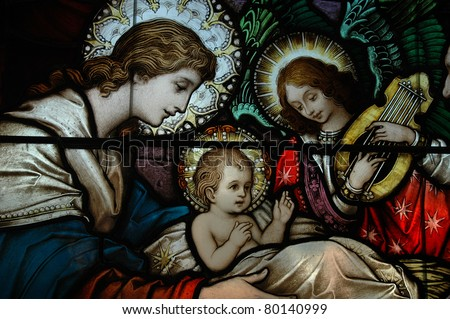 A Stained glass window in a 125 year old a Catholic Church - stock photo