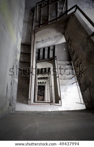 A Staircase at an abandoned factory near France. - stock photo