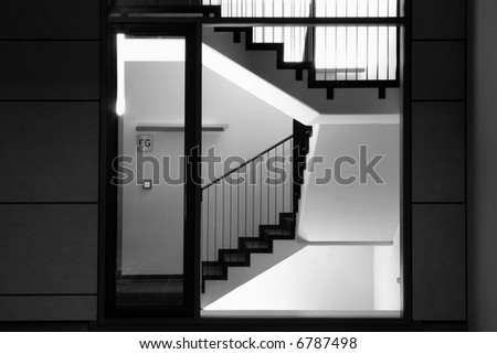 a staircase at night - stock photo