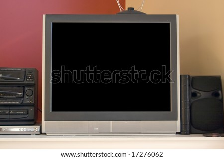 A standard picture tube tv set - 32 inch, non-widescreen.  Also in the shot is a set top antenna, stereo, and dvd player.  Includes clipping path for the screen. - stock photo