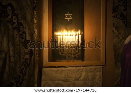 A star and candles sitting in a window. - stock photo