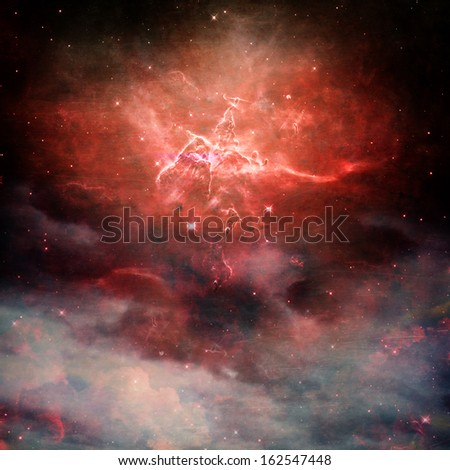 A star field in space with red nebulaes with copy space.  Elements of this image furnished by NASA. - stock photo