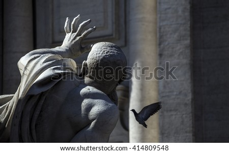 A statue in Piazza Navona, Rome, with lifelike gestures, attracting a feathered visitor - stock photo