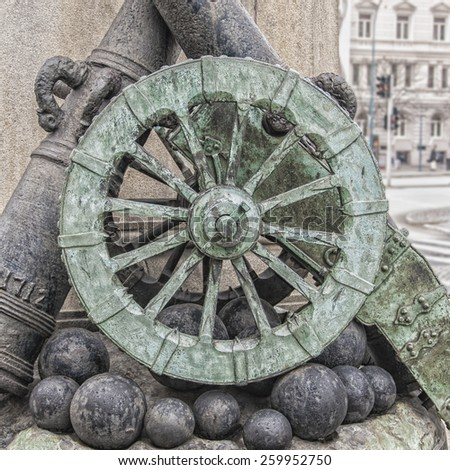 A statue of a couple of cannons, cannonballs and a wheel at the rear of the pedestal containing the Magnus Stenbock statue in Helsingborg, Sweden.  - stock photo