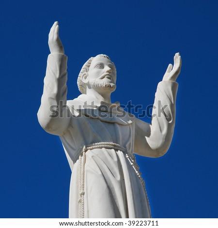 A statue of a saint near a Catholic church, Lisbon, Portugal - stock photo
