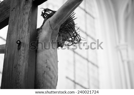 A statue of Jesus on the cross - stock photo