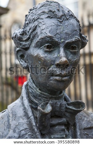 A statue of Scottish poet Robert Fergusson situated outside Canongate Kirk along the Royal Mile in Edinburgh, Scotland.