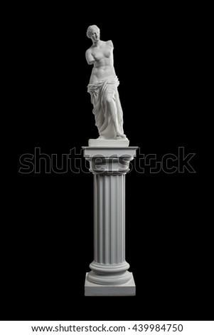 a statue of Venus, plaster column on a black background - stock photo