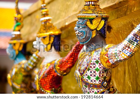 A statue of Yaksa on guard at the Temple of the Emerald Buddha - stock photo