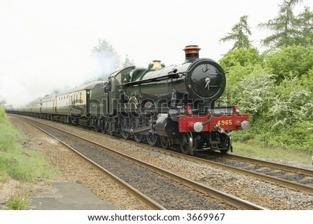 A steam engine at speed. - stock photo