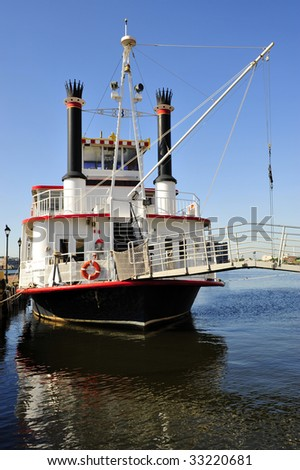 A stearn-wheeled paddle boat offers cruises of the Inner Harbor, Baltimore, MD - stock photo