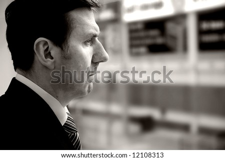 A stern looking man portrait orientation with copy space to the right. mono tobacco tone. - stock photo