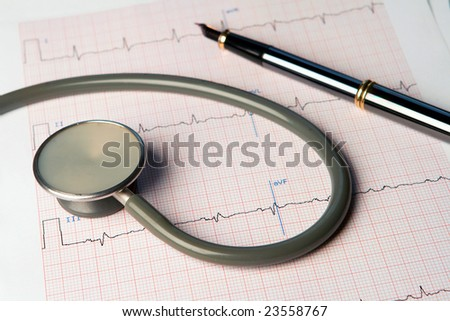 A stethoscope and an ECG with a fountain pen