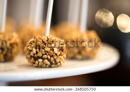 A Stick of Chocolate Mousse with Peanuts, Macro Close-up Details  - stock photo